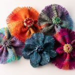 picture of different Harris Tweed brooches
