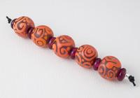 Orange and Purple Scroll Lampwork Beads