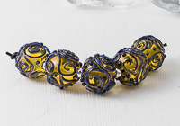 Amber Scrollwork Lampwork Beads